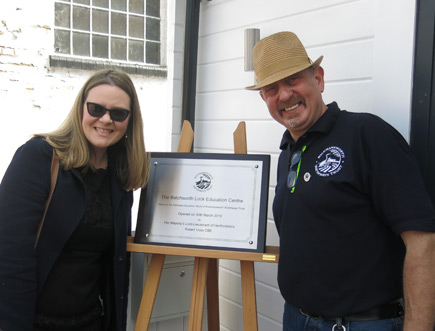 Corporate Social Responsibility Manager, Anna Jarmolinska-Nowak from Affinity Water and David Montague, Festival Director and Chairman of Rickmansworth Waterways Trust next to the commemorative plaque.
