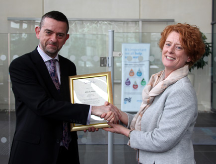 Pauline Walsh receiving the Competent Operator Scheme certification from Nick Ellins
